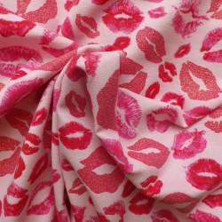 Tissu jersey à lèvres pailletées  dorées : 16.50€